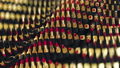 Red gold defocused lipsticks moves in rows in hypnosis surreal spinning wave dance. Fashion, glamorous magazines, sexy women, passion kisses are concentrated in this background. Infinite loop 62798781