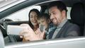 Happy young family with kid taking selfie in new auto using smartphone camera 62974655