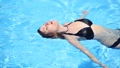 beautiful girl in a black swimsuit close up in the water 62991239