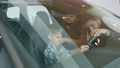 Mother, father and little boy choosing automobile in dealership touching car interior 63012439