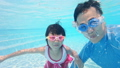 slow motion of asian cute daughter and father play and selfie happily in the swimming pool 63015856