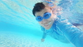 slow motion of asian man take selfie and look to you happily in the swimming pool 63015859