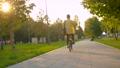 Man in yellow shirt riding a bike 63149944