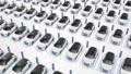 Top view of generic white electric self driving cars charging – 4K loop 63154656