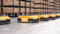 Row of autonomous robots start to move shelves or racks in automated warehouse 63161377