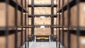 Autonomous robot or AGV moves rack in automated warehouse. Seamless looping 63161379