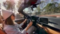 Woman driving a cabriolet while travel 63173684
