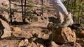 Woman hiking on a rocky land 63174995