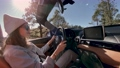Woman driving a cabriolet while travel 63174998
