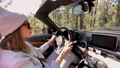 Woman driving a cabriolet while travel 63175000
