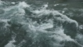 Strong water flow in a mountain river close-up 63223551