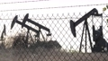 Industrial urban landscape. La Brea Inglewood in Los Angeles. Well pump jack operating behind the 63365588