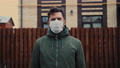 COVID-19 Man in city street wearing face mask protective for spreading of Coronavirus Disease in 63486712