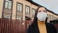 Virus mask spanish woman on street wearing face protection in prevention for coronavirus covid 19 63486737