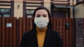 Virus mask spanish woman on street wearing face protection in prevention for coronavirus covid 19 63493051