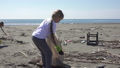 family picks up trash from the beach in trash bags 63593461