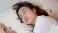 Asian woman suffers insomnia while worrying about work. 63659084