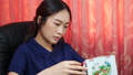 Woman looks at the calendar to see the long holiday of the year.	 63659282