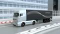 高速道路のカーブを通過する大型電動トラック 63693496