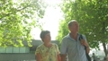 Active senior caucasian tourist couple walking in london backlit by the sun 63711679
