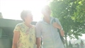 Active senior caucasian tourist couple walking in london backlit by the sun 63711681