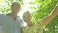 Active senior caucasian tourist couple backlit by the sun 63711682