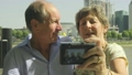 Active senior caucasian tourist couple taking a selfie on a digital camera  63711684