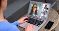 Woman talking on video meeting on her laptop 64903197