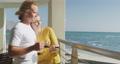 Caucasian couple enjoying their time seaside 64903203