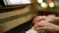 Young girl playing piano at home education 64916187