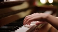 Young girl playing piano at home education 64916189