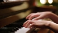Young girl playing piano at home education 64917728