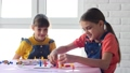 Two girls play board games joyfully and cheerfully 64925592