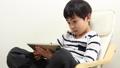 A boy using a tablet 64937282