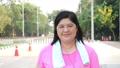 Asian fat women wear pink jogging clothes, wear earphones Listening to music  65062902