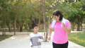 Morning Asian overweight mother wears pink exercise clothes jogging with her son with happy 65062903