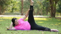 Fat Asian woman caucasian are beautiful face wearing pink exercise clothes exercising on a yoga mat 65062906