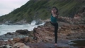 Asian woman with a slender practicing yoga on mountain 65063055