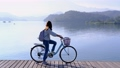 Young woman riding bicycle on Sun Moon lake bike trail, Travel lifestyle concept 65082260