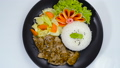 Stir Fried Pork BBQ Sauce with Sesame oil Sprinkle Sesame (DwaeGogi) Served Rice Traditional Korean Food Style on Black Plate Decorate Vegetables topview 65242940