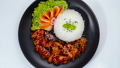 Dwaegangjeong Fried Pork with Spicy and Sweet Sauce Sprinkle Sesame Served Rice Traditional Korean Food Crispy pork Style on Black Plate Decorate Vegetables topview 65242941