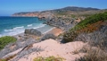 Praia do Abano tourism beach surrounded by sandy dunes. Atlantic coastline. Cascais, Portugal 65308022