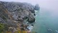 Bizarre rocky coastline near Praia da Ursa in morning fog. Sintra, Portugal 65308023