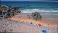 Praia do Abano beach full of tourist. Surrounded by sandy dunes. Atlantic coastline travel concept. Cascais, Portugal 65308024
