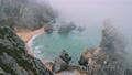Cliffs at Praia da Ursa beach in morning fog. Sintra, Portugal 65308026