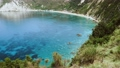 4K video of Petani beach in summer, Kefalonia island, Greece. View to Petani bay with transparent clear blue azure mediterranean sea water and green cliffs 65308046