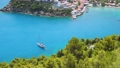 Luxury Sailing yacht in the blue bay. Vacations in mediterenean sea. Colorful harbor, remote nature of Assos village, secluded Islands in Greece. Travel adventure carefree and happiness concept. 65308047