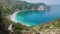 Panorama View of idyllic Petani bay with crystal clear blue azure mediterranean sea water, Kefalonia island, Greece 4k video footage 65308072