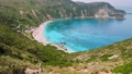 4k video of incredible beaches on Kefalonia Island. Mountains with lush greenery surrounding petani beach. clear blue water, picturesque scenic coastlines must-see destination 65308083