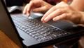 Female Hands Print On Black Laptop 65341156